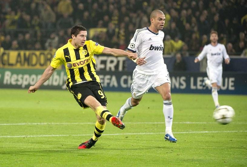 Robert Lewandowski już strzelił gola Realowi w tej edycji Ligi Mistrzów /AFP