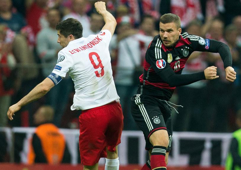 Robert Lewandowski kontra Lukas Podolski /AFP