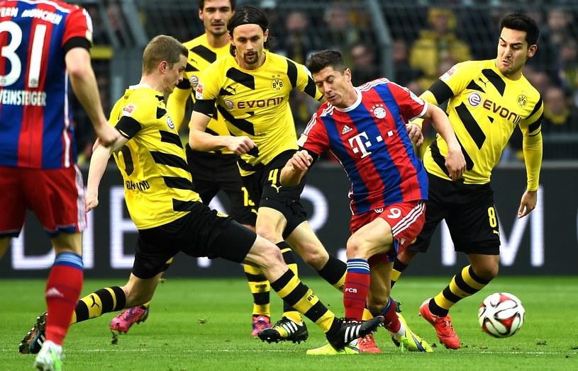 Robert Lewandowski podczas meczu z Borussią Dortmund /AFP