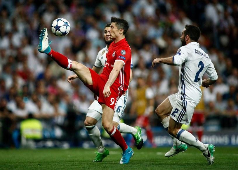 Robert Lewandowski w meczu Ligi Mistrzów z Realem Madryt /AFP