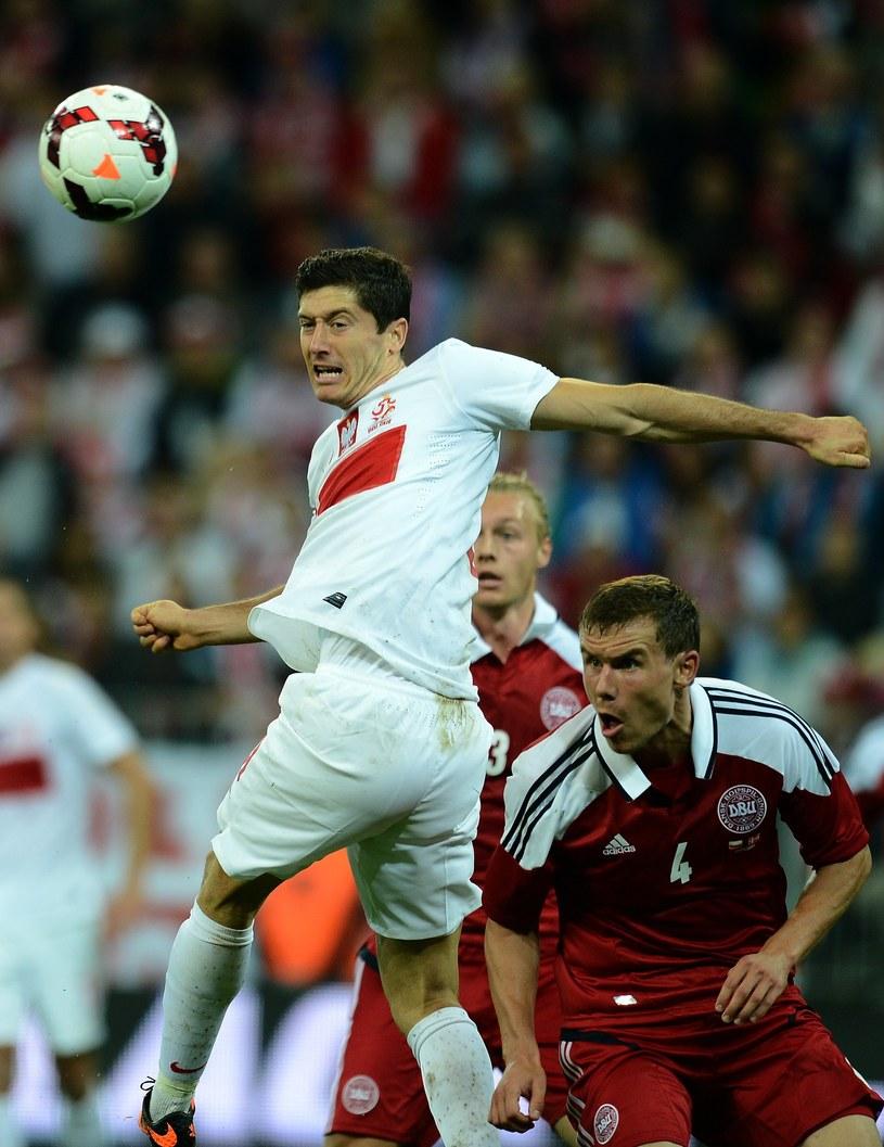 Robert Lewandowski w ostatnim meczu z Danią nie był zbyt uśmiechnięty /AFP