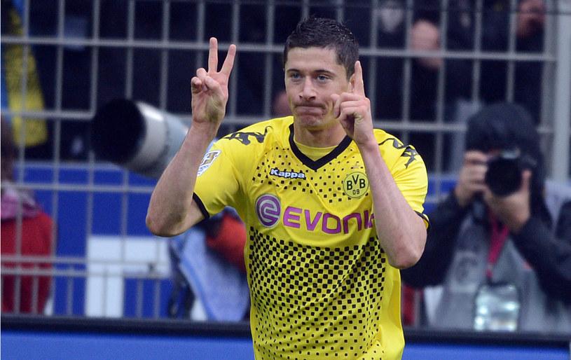 Robert Lewandowski wie, jak smakują bramki zdobyte w meczu z Bayernem /AFP