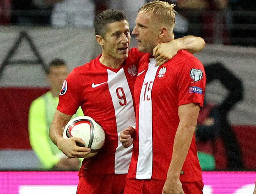 Robert Lewandowski (z lewej) i Kamil Glik /AFP