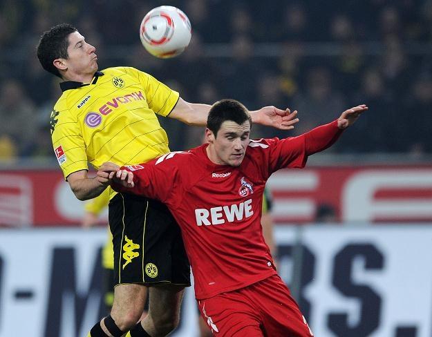 Robert Lewandowski (z lewej) strzelil jedynego gola meczu Borussia - FC Koeln /AFP