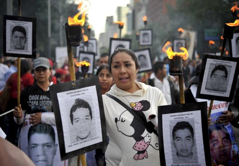 Rodziny zaginionych chcą poznać prawdę /Yuri CORTEZ / AFP /AFP