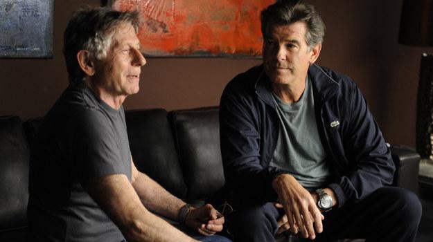 """Roman Polański i Pierce Brosnan na planie ostatniego filmu reżysera zatytułowanego """"Autor Widmo"""" /materiały prasowe"""