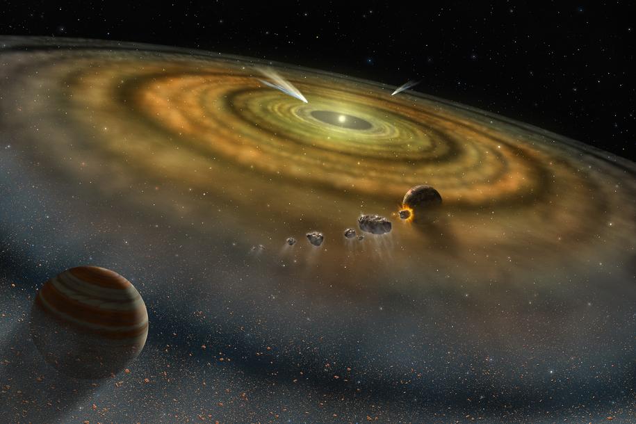 Rysunek pyłu i gazu otaczającego tworzący się Układ Słoneczny /NASA /Materiały prasowe
