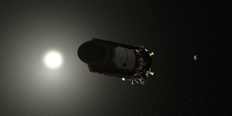 Rysunek sondy Kepler na tle Slońca i Ziemi /materiały prasowe