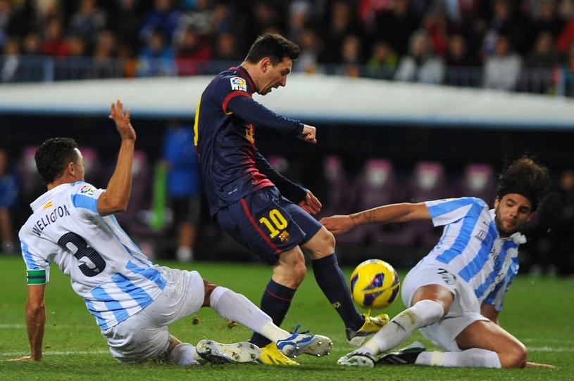 Rywale z Malagi nie mieli pomysłu na zatrzymanie Messiego /AFP