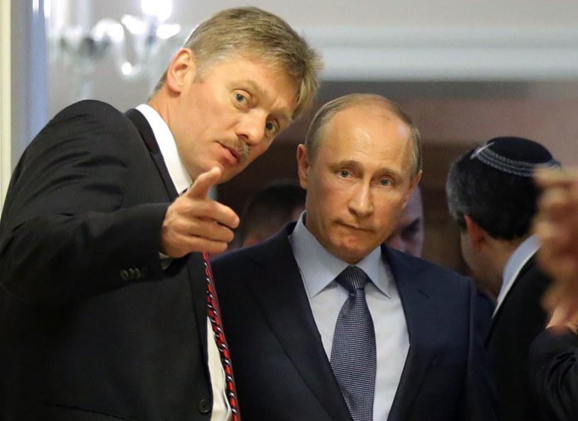 Rzecznik Kremla Dmitrij Pieskow i prezydent Władimir Putin /MAXIM SHIPENKOV    /AFP