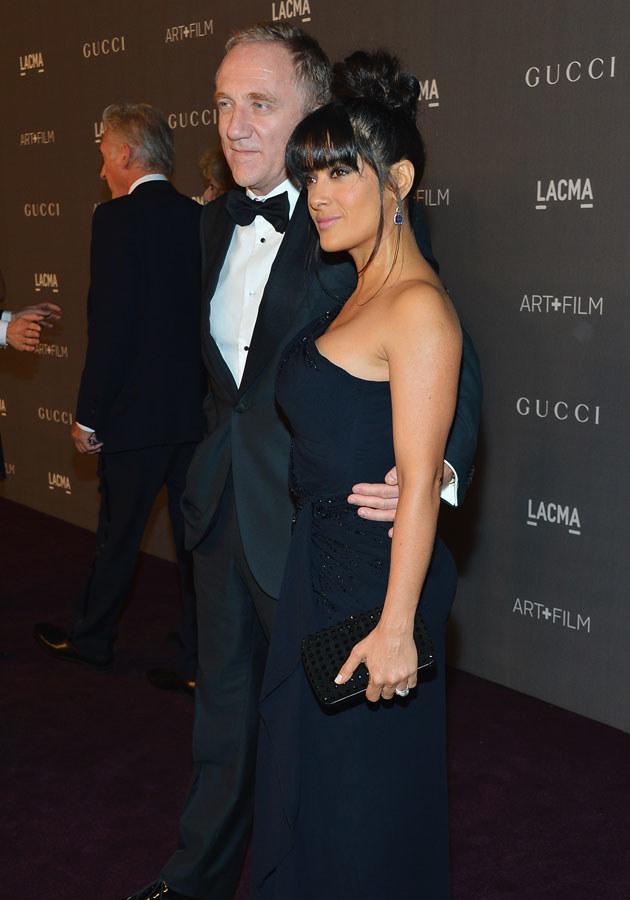 Salma jest znana ze swoich obfitych kształtów. Tu: z mężem, Francois Henrim Piquault /Frazer Harrison /Getty Images