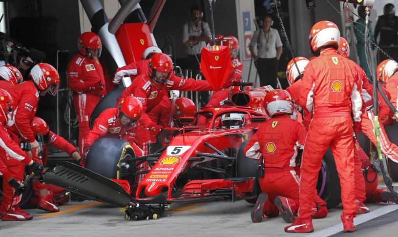Sebastian Vettel w bolidzie Ferrari /PAP/EPA