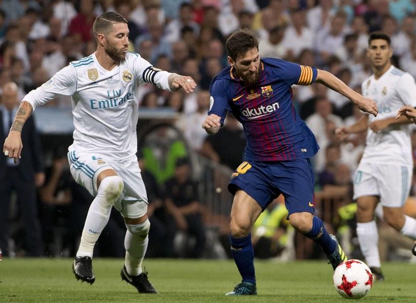 Sergio Ramos (L) i Lionel Messi /AFP