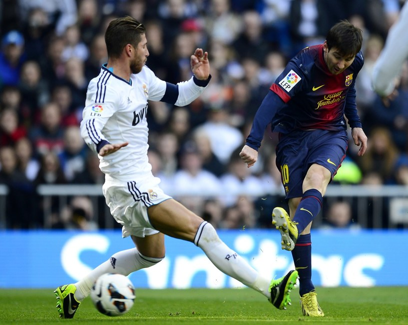 Sergio Ramos (Real Madryt, z lewej) i Lionel Messi /AFP