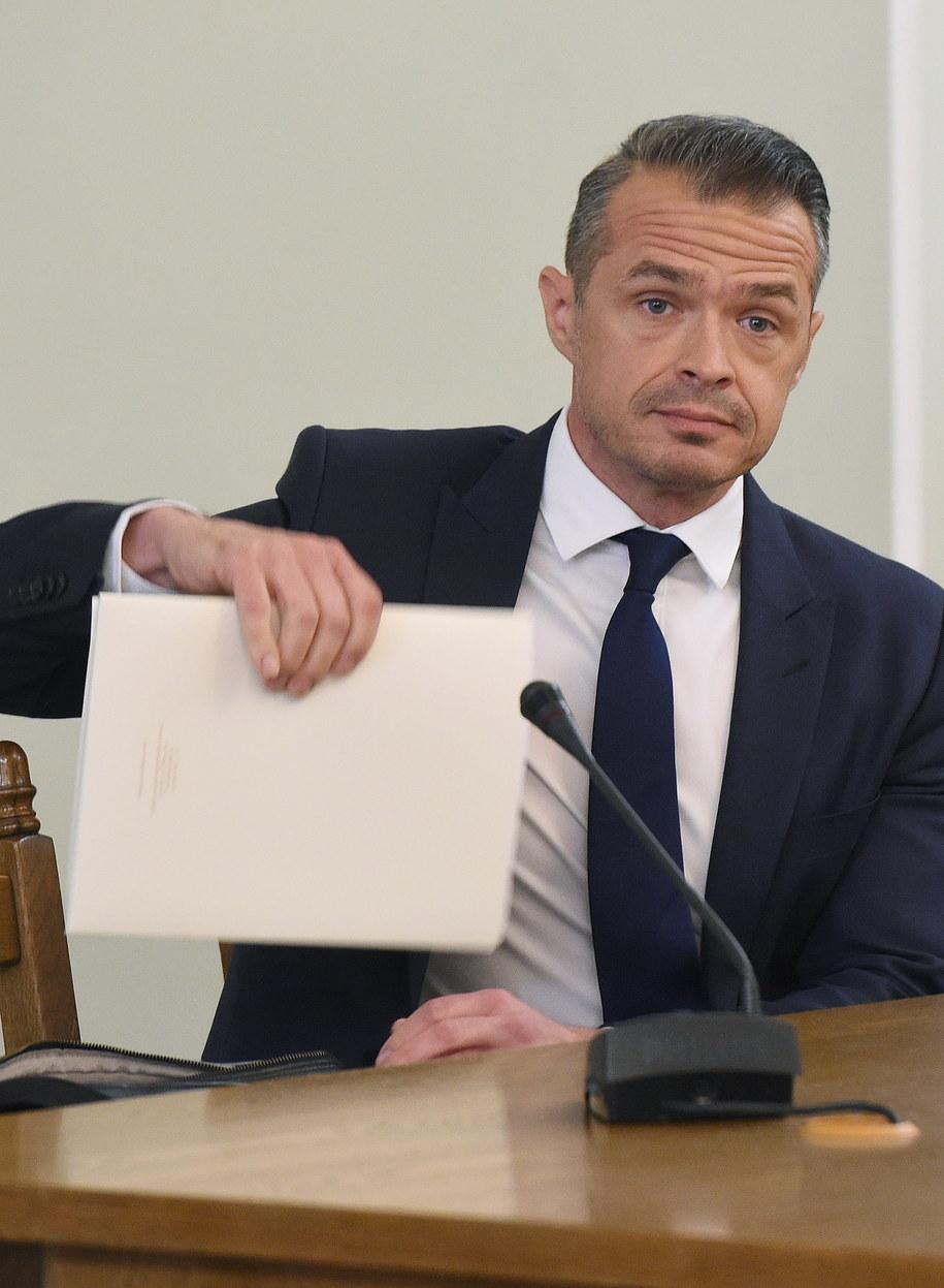 Sławomir Nowak i jego notatki /Radek Pietruszka /PAP