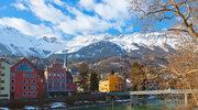 Słońce i ośnieżone szczyty Alp