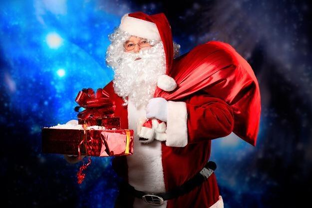 Święty Mikołaj ma w okresie świątecznym ręce pełne roboty /© Panthermedia