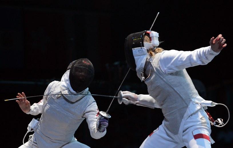 Sylwia Gruchała (z prawej) szybko pożegnała się z turniejem indywidualnym /- /AFP