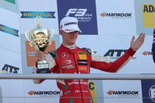 0007QHGVV65B4O16-C307 Syn Schumachera razem z Sebastianem Vettelem