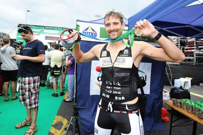 Szczęśliwy Maciej Dowbor na mecie Herbalife Triathlon Gdynia 2013 /Piotr Matusewicz /East News