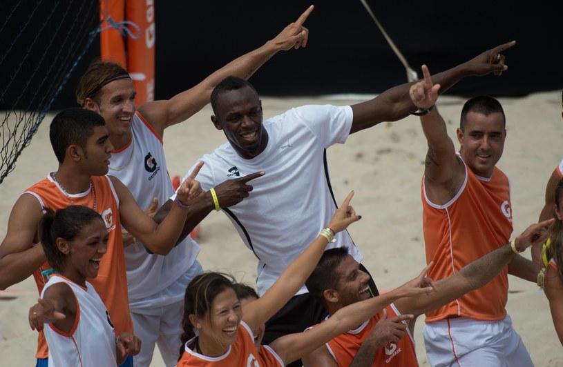 Sześciokrotny mistrz olimpijski, Usain Bolt na plaży Copacabana /AFP