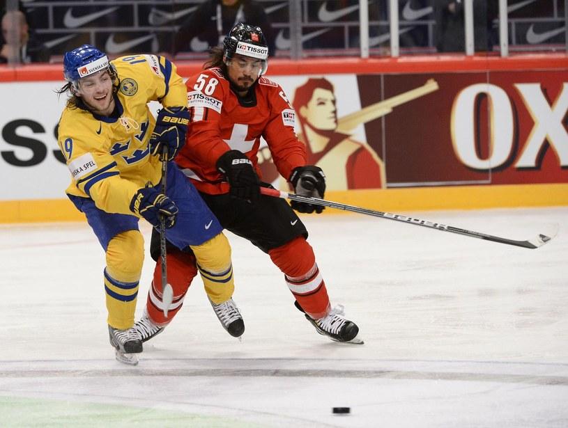 Szwed Calle Jarnkrok (z lewej) i Szwajcar Eric Blum /AFP