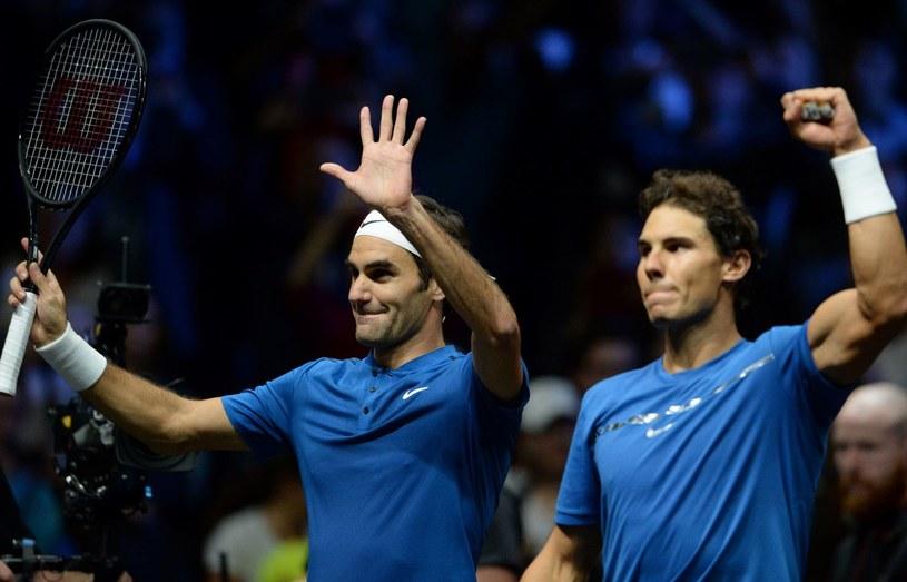 Tenisiści Rafael Nadal (z prawej) i Roger Federer /AFP