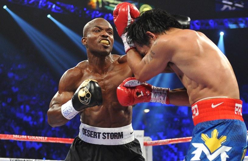 Timothy Bradley (z lewej) w walce z Mannym Pacquiao /AFP