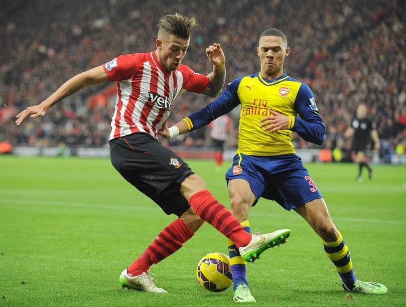 Toby Alderweireld (na zdjęciu z lewej) podczas meczu z Arsenalem /AFP