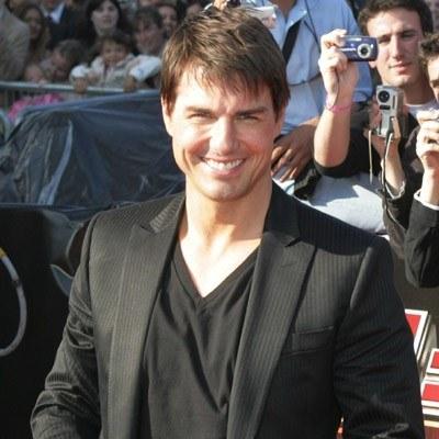 Tom Cruise spóźnił się ze sprzedażą zdjęć swojej córeczki /AFP