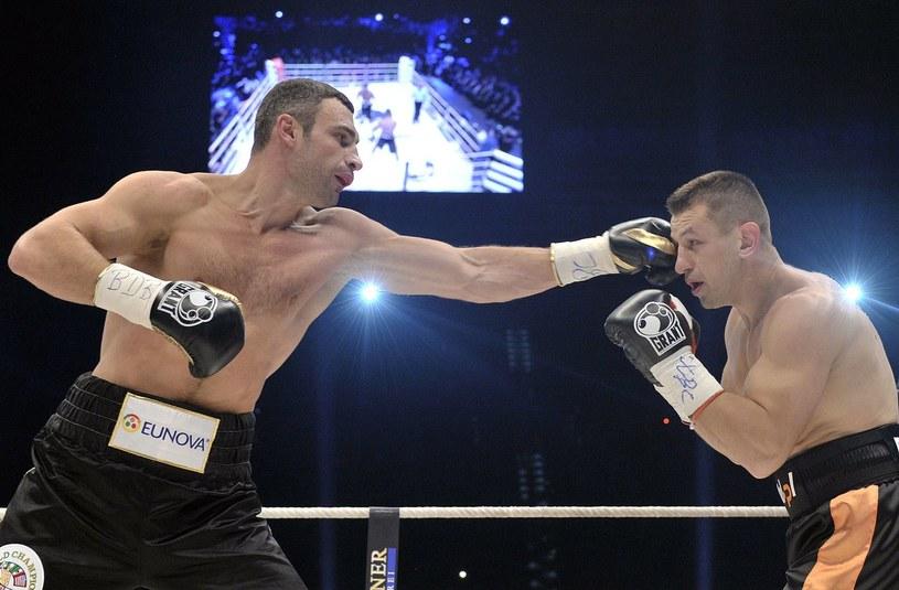 Tomasz Adamek podczas walki z Witalijem Kliczką /AFP