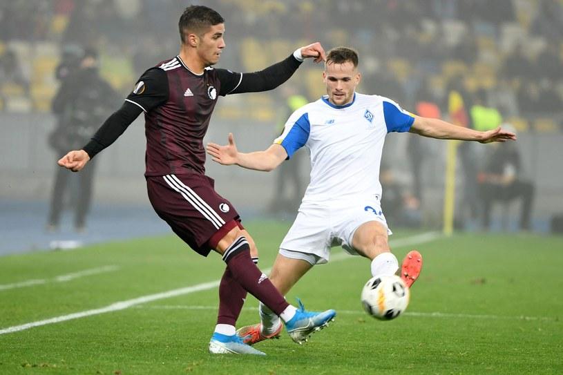 Tomasz Kędziora i Pieros Sotiriou w meczu Dynamo Kijów - FC Kopenhaga /AFP