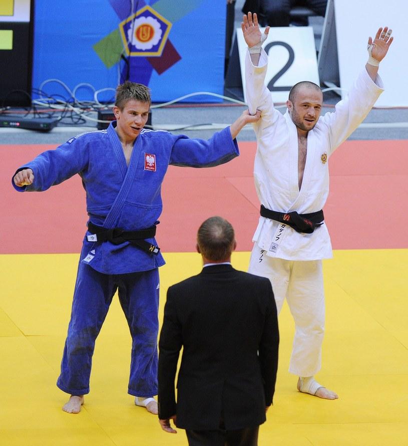 Tomasz Kowalski (w niebieskim stroju) /AFP