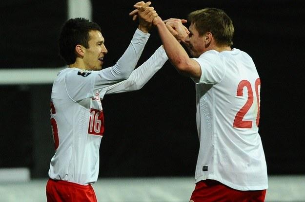 Tomasz Kupisz (z prawej) w barwach reprezentacji Polski /AFP