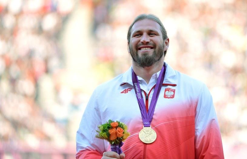 Tomasz Majewski zdobył w Londynie złoty medal /AFP