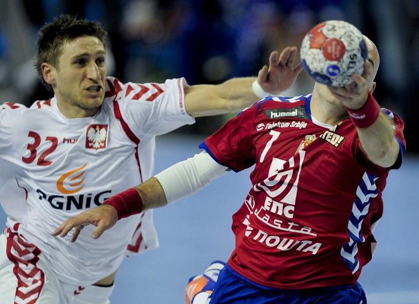 Tomasz Rosiński (z lewej) nie zagra w mistrzostwach świata w Hiszpanii /AFP
