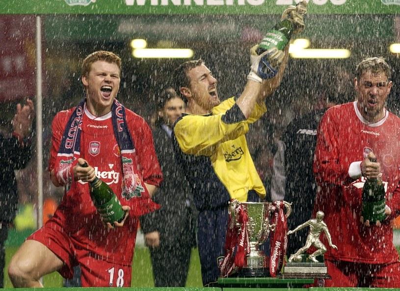 Triumfujący piłkarze Liverpoolu /AFP