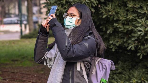Turystka z Azji w masce ochronnej we Włoszech / Matteo Corner, Ansa /PAP/EPA