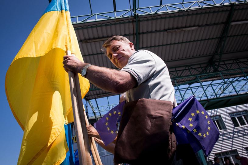 Tylko 11 proc. badanych Ukraińców chce się osiedlić w Polsce na stałe /AFP