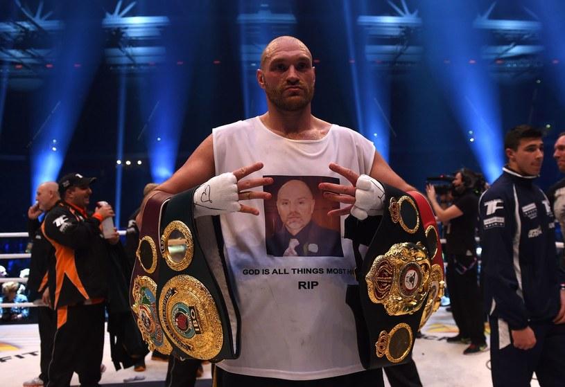 Tyson Fury zdobył mistrzowskie pasy po zwycięstwie nad Władimirem Kliczką /AFP