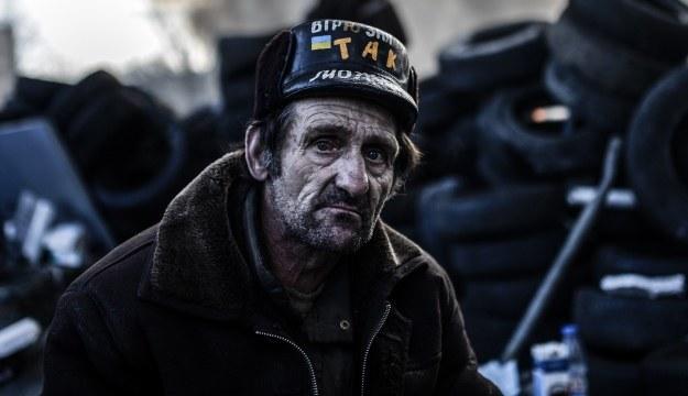 Uczestnik antyrządowych protestów w Kijowie /AFP