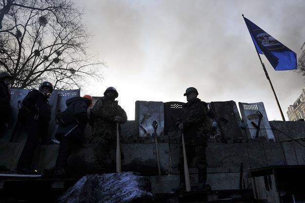Ukraina jest gospodarczym bankrutem. Potrzebuje 150 mld euro /AFP