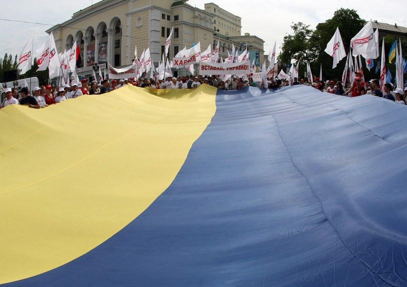 Ukraina zarabia w Polsce... /AFP