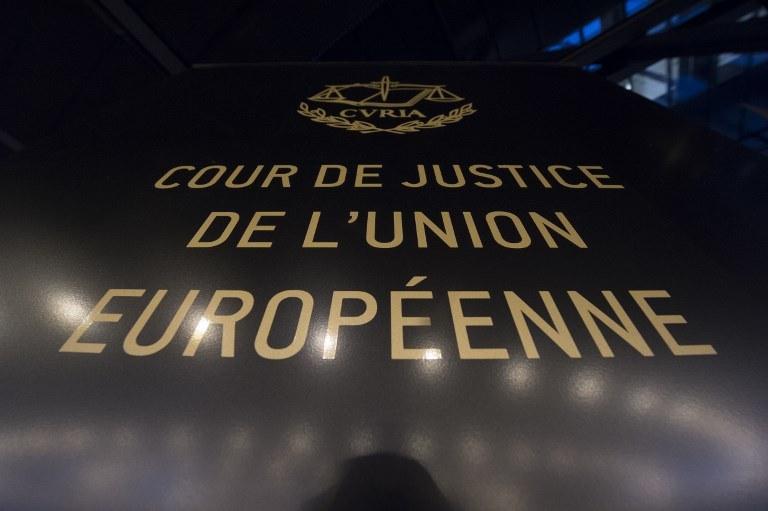 Unijny Trybunał nie podjął żadnej merytorycznej decyzji w sprawie Polski /JOHN THYS /AFP