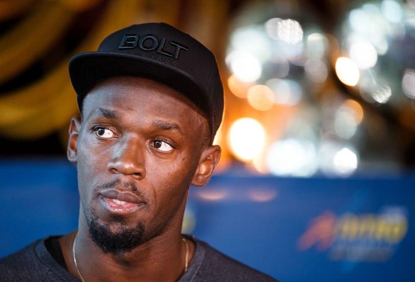 Usain Bolt podczas konferencji prasowej w Melbourne /AFP