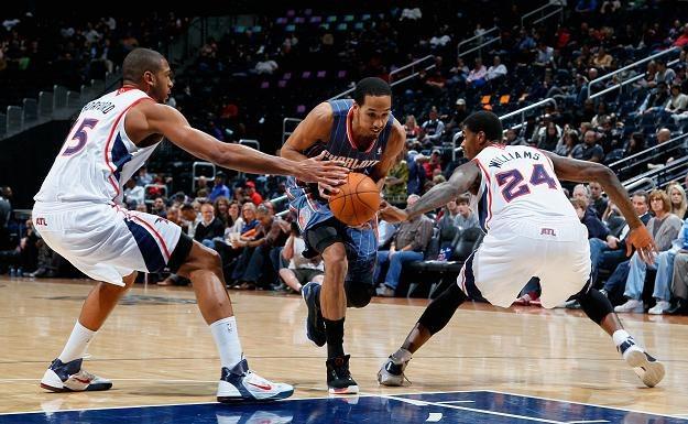 W spotkaniu Charlotte Bobcats z Atlanta Hawks nie zabrakło ostrej walki /AFP
