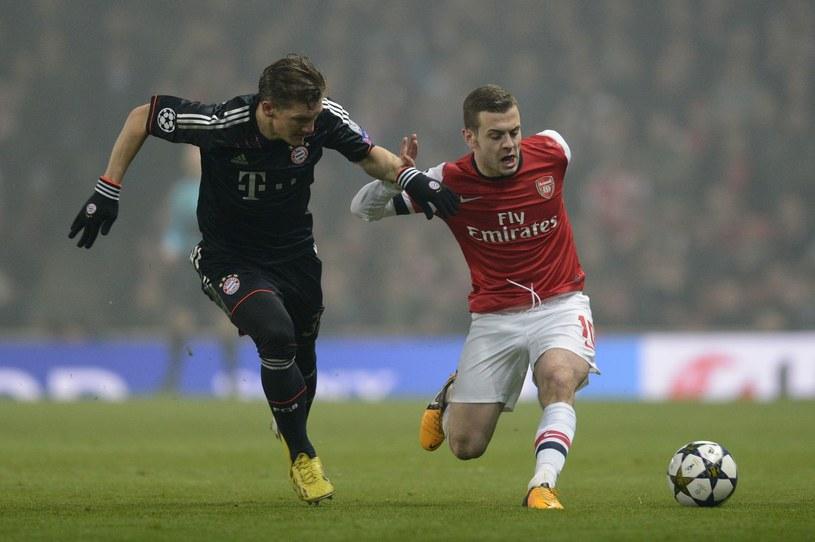 W środowym meczu nie zobaczymy zarówno Bastiana Schweinsteigera (z lewej) i Jacka Wilshere'a /AFP