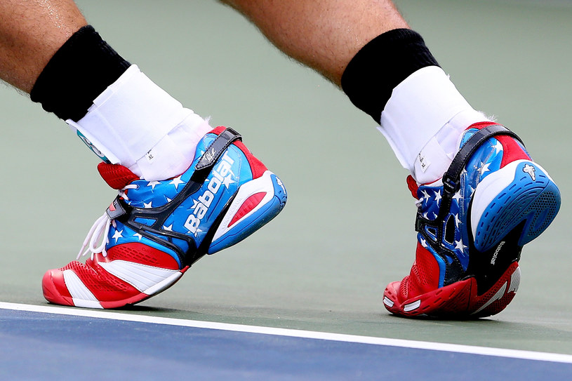 W takich butach Andy Roddick zagrał w ostatnim meczu /AFP