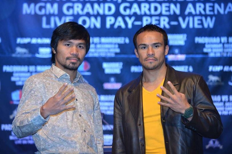 Walka Manny'ego Pacquiao (z lewej) z Juanem Manuelem Marquezem odbędzie się 8 grudnia w Las Vegas /AFP