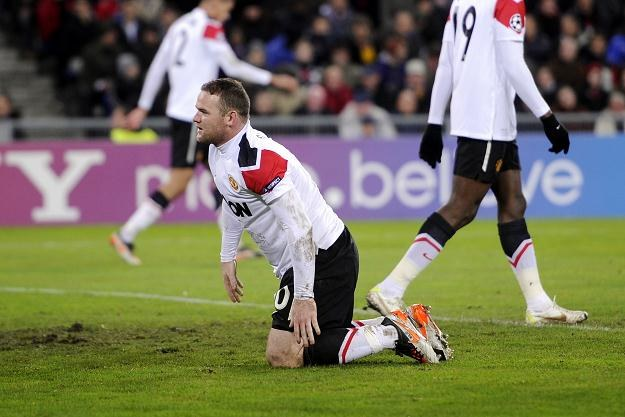 Wayne Rooney i jego koledzy nie popisali się w meczu z FC Basel /AFP